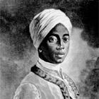 Angelo Soliman wurde in Nordnigeria geboren, fiel im Alter von sieben jahren Sklavenhändlern in die Hände und wurde nach Europa verschleppt. Er landete als Hofdiener in Wien, wo er als Schachmeister und in sechs Sprachen parlierend gewisse Anerkennung errang. Freimaurerischer Logenbruder Mozarts, verheiratet, eine Tochter: Josephine. Er starb 1796 als Wiener Bürger und kaiserlicher Offizier. Nach seinem Tod wurde er ausgestopft und halbnackt in exotischen Kleidern neben ausgestopften Tieren in tropischer Kulisse des k. u. k. Hof-Naturalienkabinetts zur Schau gestellt.